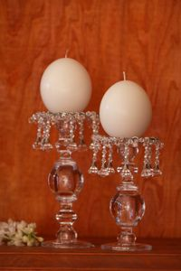 30 cm Single glass candle stick + small taperd. 30 cm Single glass candle stick + ostrich egg. 25 cm Single glass candle stick + lida crystal